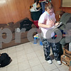 Beck Diefenbach  -  bdiefenbach@daily-chronicle.com<br /> <br /> Mindy Albright sifts through mail in her DeKalb apartment after a 12 hour shift at one of her two jobs on Saturday May 2, 2009. Mindy and her two sons, Evan McCormick, right, and Dominic moved into their new home on April 1.