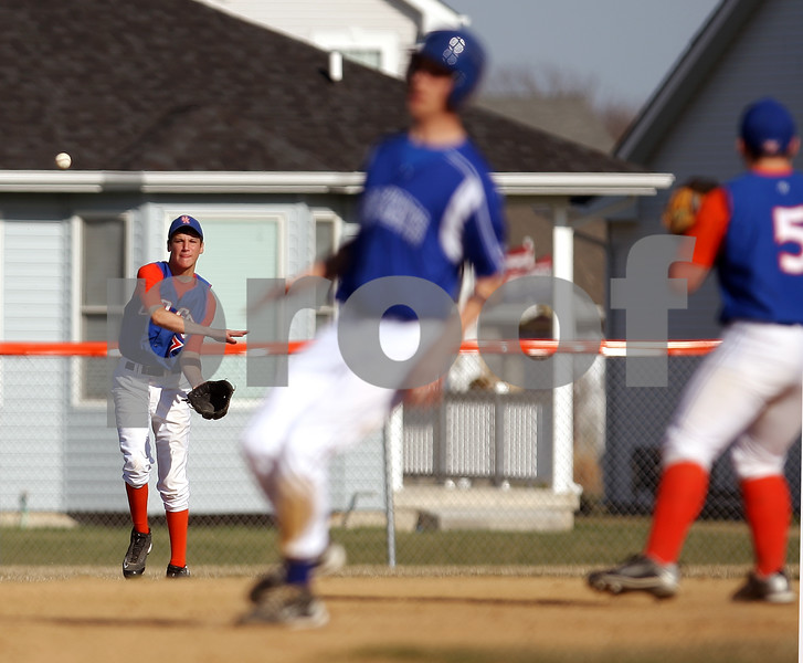 Beck Diefenbach  -  bdiefenbach@daily-chronicle.com<br /> <br /> Genoa Kingston's Gage Windau (7) throws the ball to third baseman John Cwiok too late for the out during the top of the third inning against Burlington Central at GK High School in Genoa, Ill., on Friday April 17, 2009.