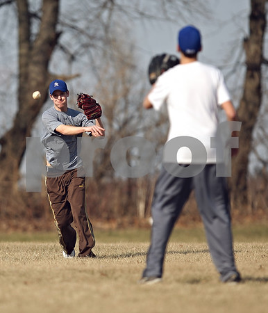 Beck Diefenbach  -  bdiefenbach@daily-chronicle.com<br /> <br /> Hinckley-Big Rock's Colton Craig throws the ball to Brandon Dillenbeck during practice at HBR High School in Hinckley, Ill., on Monday March 16, 2009.