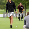 Rob Winner – rwinner@daily-chronicle.com<br /> Hayley Guyton of the Kaneland golf team leaves the second hole green during a match against Marengo at the Hughes Creek Golf Club in Elburn recently.<br /> 08/27/2009