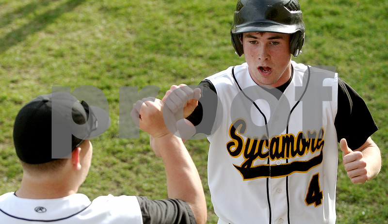 Rob Winner – rwinner@daily-chronicle.com<br /> Sycamore's David Salvatore (left) greets Kyle Landes after scoring a run in the third inning. Landes got on base with a single, stole second, and while attempting to steal third, an error on the throw allowed him to score.<br /> 04/24/2009<br /> Please check with Gerts that this happened in the third and Landes reached on a single