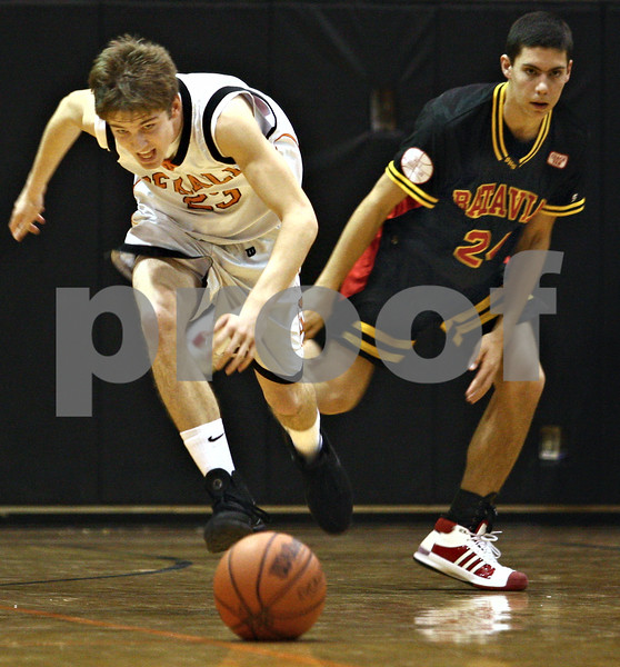 Beck Diefenbach  -  bdiefenbach@daily-chronicle.com<br /> <br /> DeKalb guard Dylan Donnelly (23) looses the ball after he is fouled by Batavia guard Jesse Coffey (24) during the fourth quarter of the game at DeKalb High School in DeKalb, Ill., on Wednesday Jan. 14, 2008. DeKalb beat Batavia 46 to 34.