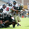 Beck Diefenbach – bdiefenbach@daily-chronicle.com<br /> <br /> Northern Illinois' Tracy Wilson (25) and Cory Hanson (26) take down Purdue (8) during the first half of the game against Purdue University in West Lafayette, Ind., on Saturday Sept. 19, 2009