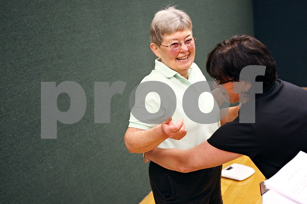 Beck Diefenbach  -  bdiefenbach@daily-chronicle.com<br /> <br /> Corki Williams has her waist measured by registered nurse Marla Barresi for her final weigh-in for Weigh No More at the Kishwuakee YMCA in Sycamore, Ill., on Monday May 11, 2009.