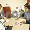 Beck Diefenbach  -  bdiefenbach@daily-chronicle.com<br /> <br /> Universal relationship banker Maury Dobbel speaks with a Spanish speaking customer at National Bank and Trust Company branch in DeKalb, Ill., on Tuesday Jan. 27, 2009. Dobbel is a bilingual professional who speaks both English and Spanish.