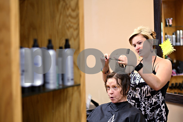 Beck Diefenbach  -  bdiefenbach@daily-chronicle.com<br /> <br /> Fay Allen, of Malta, gets her hair cut by stylist Amie Bemis at Unique Concepts in Sycamore, Ill., on Tuesday June 23, 2009. The salon will soon be using environmentally friendly chemicals and Owner Patty Pumfrey will have the first salon in northern Illinois to be certified as green.