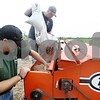 Beck Diefenbach  -  bdiefenbach@daily-chronicle.com<br /> <br /> Potawatomi land manager Chris Decoteau, left, and rural crop assistant Duane Daugherty fill a no-till drill with seeds of native grasses before planting sections of former farmland outside Shabbona, Ill., on Tuesday June 16, 2009.