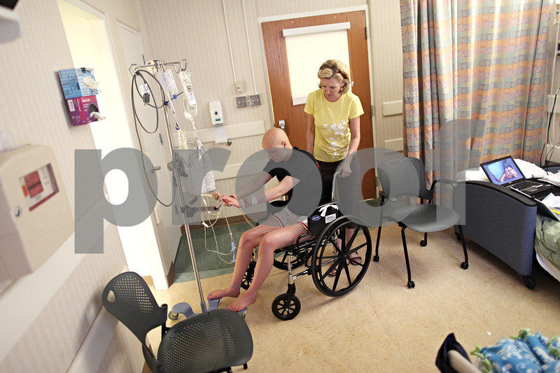 Beck Diefenbach  -  bdiefenbach@daily-chronicle.com<br /> <br /> Grace Waller's mother Jacque helps her reach the bathroom while in observation following another round of chemotherapy at Rush Medical Hospital in Chicago on Saturday July 18, 2009.