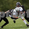 Rob Winner - rwinner@daily-chronicle.com<br /> <br /> Taylor Andrews of Kaneland picks up a few yards after a reception during the first half.<br /> <br /> 10/10/2009