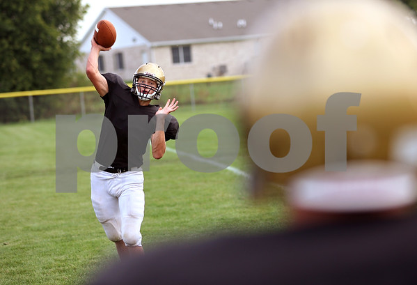 Beck Diefenbach  -  bdiefenbach@daily-chronicle.com<br /> <br /> Sycamore quarterback Ryan Bartels warms up during practice at Sycamore High School in Sycamore, Ill., on Wednesday Sept. 9. 2009.