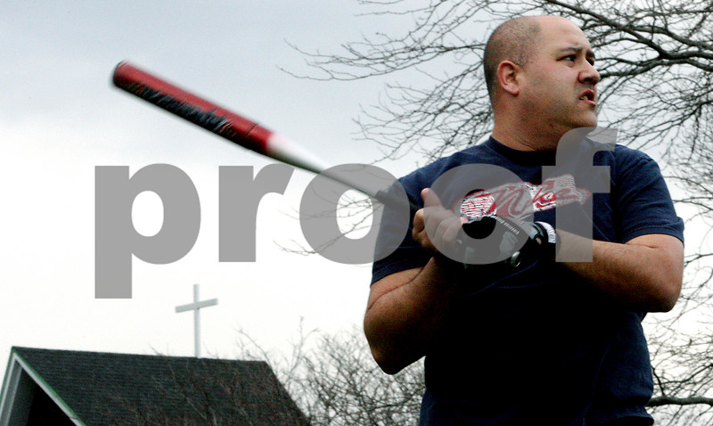 Rob Winner – rwinner@kcchronicle.com<br /> Brian Kozumplik, of Sycamore, waits for a pitch during a recent practice of the Immanuel Lutheran softball team in DeKalb.<br /> 04/23/2009