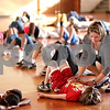 Beck Diefenbach  -  bdiefenbach@daily-chronicle.com<br /> <br /> Physical Education teacher Lisa Boyle helps a third grader with his posture during yoga warm ups for P.E. class at Malta Elementary School in Malta, Ill., on Tuesday Sept. 8, 2009.