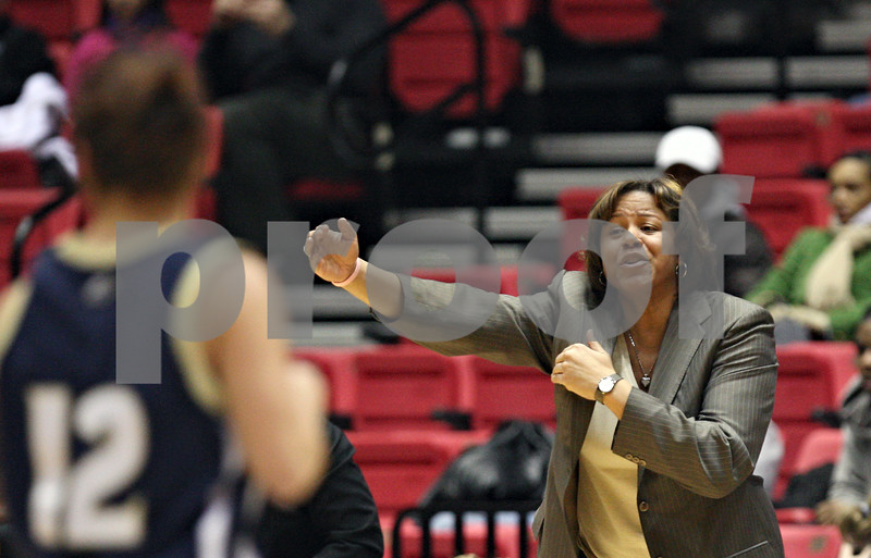Beck Diefenbach  -  bdiefenbach@daily-chronicle.com<br /> <br /> Northern Illinois head coach Jodi Kest gives instructions to her players during the first half of the game against Akron at Northern Illinois' Convocation Center in DeKalb, Ill., on Wednesday Feb. 4, 2009.