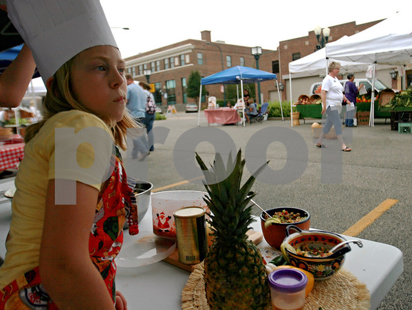 Randi Stella – rstella@daily-chronicle.com<br /> <br /> Sydney Sandberg, age 10 from Malta, checks out the competition at the Salsa Challenge in Sycamore, Ill., Sunday, August 16th, 2009.