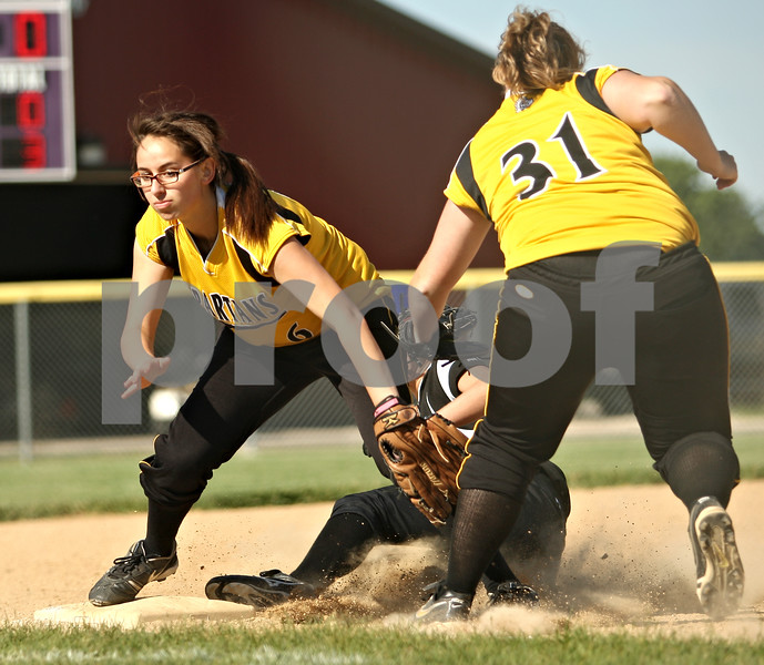 Beck Diefenbach  -  bdiefenbach@daily-chronicle.com<br /> <br /> Neither Sycamore's Haley Salazar (6) nor Rachel Lesorgen (31) can stop Burlington Central's Ashley Scheffler (16) for sliding in safe at third base during the bottom of the fourth inning of the Class 3A Rochelle Sectional semi-final game at Rochelle High School in Rochelle, Ill., on Wednesday June 3, 2009.