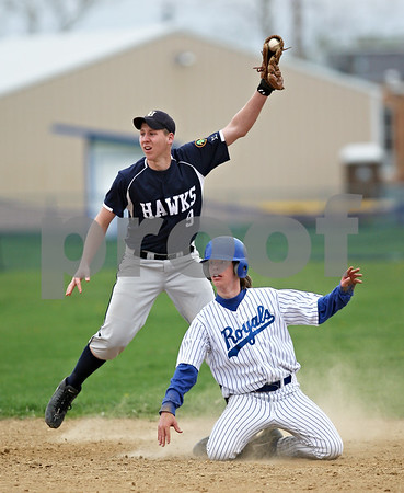 Beck Diefenbach  -  bdiefenbach@daily-chronicle.com<br /> <br /> Hinckley-Big Rock's Jack Peters (7) and Hiawatha's Floyd Webster (9) look to the umpire for the call after Peters slide into second base during the fourth inning of the game at HBR High School in Hinckley, Ill., on Tuesday April 28, 2009.