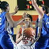 Beck Diefenbach  -  bdiefenbach@daily-chronicle.com<br /> <br /> DeKalb forward Deyonna Dunigan (22) attempts to shoot the ball between Larkin forwards Tatiana Holbert (32) and Lindsey Casebeer (14) during the second quarter of the South Elgin Regional quarterfinal game at South Elgin High School in South Elgin, Ill., on Monday Feb. 16, 2009.