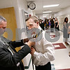 Beck Diefenbach  -  bdiefenbach@daily-chronicle.com<br /> <br /> Graduating senior Jerry Oldman (right) gets his tie tied by teacher Jon Womack before the ceremony at Sycamore High School in Sycamore, Ill., on Sunday May 31, 2009.