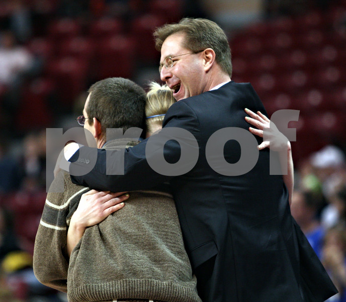 Beck Diefenbach – bdiefenbach@daily-chronicle.com<br /> <br /> From left, Hinckley-Big Rock's head coach Greg Burks, Jes Meyer and assistant coach Don Rasich  embrace seconds before defeating Winchester West Central in the Class 1A State Championship at the Redbird Arena in Normal, Ill., on Saturday Feb. 28, 2009.