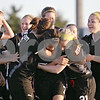 Beck Diefenbach  -  bdiefenbach@daily-chronicle.com<br /> <br /> Sycamore's Emma Norris, center, is surrounded by teammates after she scores the winning goal in overtime during the IHSA Class 2A Sectional final game against Freeport Lady Pretz at Belvidere High School in Belvidere, Ill., on Friday May 29, 2009.
