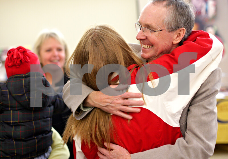 Beck Diefenbach  -  bdiefenbach@daily-chronicle.com<br /> <br /> Mayor Kris Povlsen, far right, hugs his daughter Karissa, 22, during his retirement party at the the Ben Gorden Center in DeKalb, Ill., on Wednesday Jan. 13, 2010.