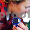 Beck Diefenbach  -  bdiefenbach@daily-chronicle.com<br /> <br /> Center, Christa Kennett, senior at Northern Illinois University, holds the solar panel to her plastic toy crab during a workshop combining solar power and art as part of the NIU Women's Studies Program at the Holmes Student Center at NIU in DeKalb, Ill., on Tuesday March 17, 2009.