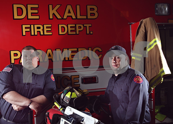 Beck Diefenbach  -  bdiefenbach@daily-chronicle.com<br /> <br /> Firefighter Paramedics Jim Morton, left, and Steve Cruz stand with some of their gear they need to complete their job, including Medic 5, one of the department's ambulances.