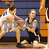 Beck Diefenbach  -  bdiefenbach@daily-chronicle.com<br /> <br /> Genoa-Kingston forward Alex Carroll (35) and Byron's Emily Lehne (23) play tug-of war for the ball during the second quarter of the game at Genoa-Kingston High School in Genoa, Ill., on Tuesday Jan. 27, 2009. Byron beat GK 41 to 38.
