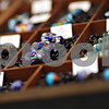 Beck Diefenbach  -  bdiefenbach@daily-chronicle.com<br /> <br /> Hand-made glass beads by Allison Johnson sit on display for sale at her new store Bliss Beads Studio and Gallery at 161 E. Lincoln Hwy., in DeKalb, Ill., on Friday Feb. 13, 2009. Johnson also conducts glass bead making classes.