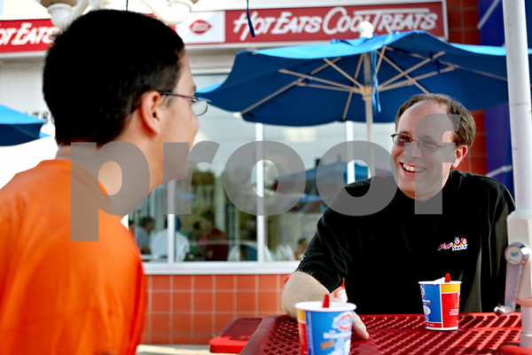 Rob Winner – rwinner@daily-chronicle.com<br /> After finishing a snack at the Dairy Queen in DeKalb on Tuesday afternoon, Josh Waffle (left), 17, and his Big Brother Doug Teckenbrock have a conversation.<br /> 08/04/2009