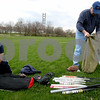 Rob Winner – rwinner@kcchronicle.com<br /> Immanuel Lutheran's Brian Kozumplik (left) and assistant coach Jeff Hoffman dig through their softball equipment before a recent practice in DeKalb.<br /> 04/23/2009