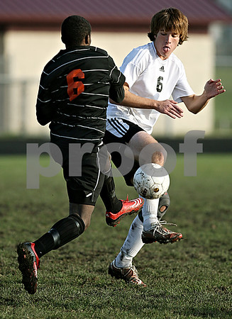 Rob Winner – rwinner@daily-chronicle.com<br /> Devin Edwards (left) and Andrew Wallace battle for possession during the IHSA Class 2A Freeport Sectional semifinal in Belvidere on Tuesday October 27, 2009.