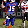 Rob Winner – rwinner@daily-chronicle.com<br /> <br /> Genoa-Kingston quarterback Craig Billington looks for an open receiver during Friday night's game.<br /> <br /> 10/16/2009
