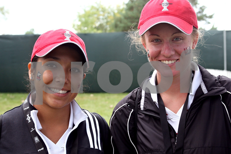 Rob Winner – rwinner@daily-chronicle.com<br /> Mandi Vavrinchik (left) and Laura Schutte, of the NIU golf team, volunteered as ball markers for the Solheim Cup in Sugar Grove.<br /> 08/21/2009