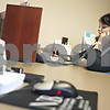 Beck Diefenbach  -  bdiefenbach@daily-chronicle.com<br /> <br /> Universal relationship banker Maury Dobbel speaks on the phone with another National Bank and Trust Company branch in Genoa, Ill., in English at the NB&T location in DeKalb, Ill., on Tuesday Jan. 27, 2009. Dobbel is a bilingual professional who speaks both English and Spanish.