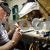 Beck Diefenbach – bdiefenbach@daily-chronicle.com<br /> <br /> Jeweler Gary Cook mends a broken gold necklace at his store Golden Dreams in Sycamore, Ill., on Monday Feb. 23, 2009. Cook specialized in transforming old jewelry into new pieces, a service which he can also be paid for in gold.