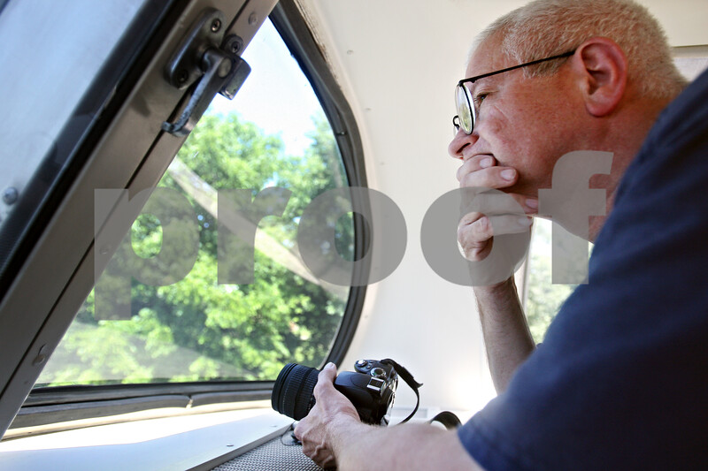 Beck Diefenbach  -  bdiefenbach@daily-chronicle.com<br /> <br /> Mt. Morris firefighter Jerry Stauffer looks out a window of the Union Pacific Safety Train on Tuesday June 23, 2009.