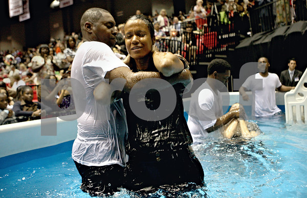 Rob Winner – rwinner@daily-chronicle.com<br /> Anna Hutchison (front), of Markham, and Abigail Trotter, of Chicago, are baptized on Saturday afternoon at the Convocation Center in DeKalb during the annual district convention of Jehovah's Witnesses.<br /> 07/25/2009