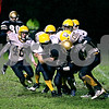 Rob Winner – rwinner@daily-chronicle.com<br /> Hiawatha's Jake Papke holds onto a reception and drags a pile of Luther North defenders late in the first half. Hiawatha hosted Luther High School North on Friday night.<br /> 10/02/2009