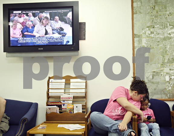 Beck Diefenbach  -  bdiefenbach@daily-chronicle.com<br /> <br /> Teacher Tanya Ingraham and her student Amiya Dunn from Once Upon a Time Child Care listen from the hallway during the open hearing portion of the city council meeting at the City Municipal building in deKalb, Ill., on Monday June 8, 2009.
