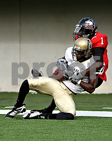 Rob Winner – rwinner@daily-chronicle.com<br /> Idaho's Isaac Butts (front) is able to break up a touchdown pass intended for NIU's Martel Moore during the third quarter. The Huskies eventually had to settle for a field goal.<br /> 09/26/2009