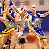 Beck Diefenbach  -  bdiefenbach@daily-chronicle.com<br /> <br /> Somonauk's Ashlee Kawall (23, far right) knocks the ball away from Genoa-Kingston's Molly Meier (33) during the fourth quarter of the game of the G-K Christmas Tournament at G-K High School in Genoa, Ill., on Tuesday Dec. 15, 2009.