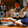 Rob Winner – rwinner@daily-chronicle.com<br /> DeKalb's Evan Jones is taken to the mat by Prospect's Yousef Avubakr during their 125-pound match at the Don Flavin Wrestling Tournament in DeKalb, Ill. on Tuesday December 29, 2009.