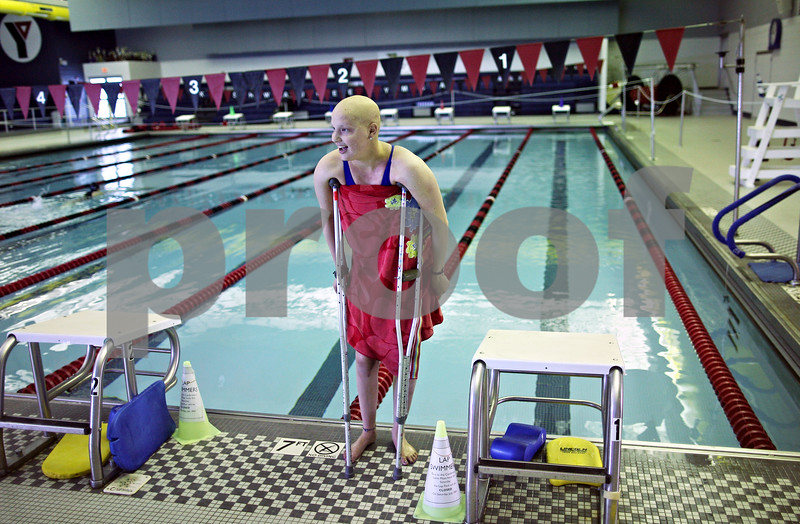 Beck Diefenbach  -  bdiefenbach@daily-chronicle.com<br /> <br /> Grace Waller stands using her crutches after swimming practice at the Kishwuakee YMCA in Sycamore, on Wednesday July 15, 2009. Last year, Waller won 11th in the 200-yard individual medley at the state meet.. Now she tries to swim between chemotherapy treatments.