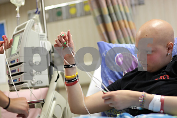 Beck Diefenbach  -  bdiefenbach@daily-chronicle.com<br /> <br /> Grace Waller untangles her IV cord while in observation following another round of chemotherapy at Rush Medical Hospital in Chicago on Saturday July 18, 2009.