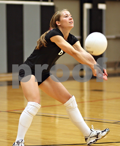 Beck Diefenbach – bdiefenbach@daily-chronicle.com<br /> <br /> Kaneland's Tara Groen (6) returns the ball during the second period of the game against DeKalb High School at Kaneland High School in Maple Park, Ill., on Saturday Sept. 19, 2009.