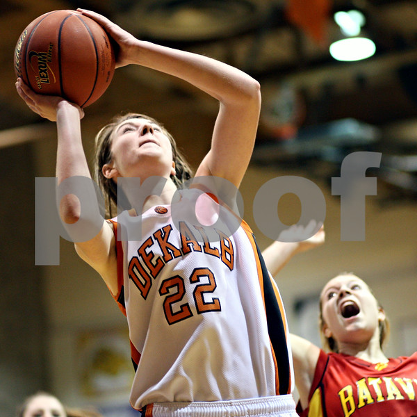 Beck Diefenbach  -  bdiefenbach@daily-chronicle.com<br /> <br /> DeKalb's Emily Bemis (22, left) shoots the ball during the fourth quarter of the game against Batavia at DeKalb High School in DeKalb, Ill., on Tuesday Dec. 8, 2009. DeKalb defeated Batavia 33 to 21.