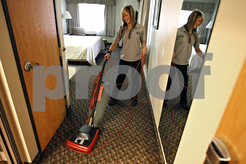 Rob Winner – rwinner@daily-chronicle.com<br /> <br /> Sandwich High School student Britannie Rousseau, 17, vacuums a guest room at the Best Western Timber Creek Inn & Suites in Sandwich on Tuesday October 20, 2009.