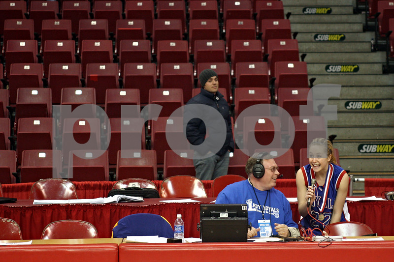 Beck Diefenbach – bdiefenbach@daily-chronicle.com<br /> <br /> Hinckley-Big Rock Maxzine Rossler (far right) speaks with Jim Teckenbrock of 107.1 FM WSPY after her team beat Winchester West Central High School in the Class 1A IHSA State Basketball Championships at the Red Bird Arena in Normal, Ill., on Saturday Feb. 28, 2009.