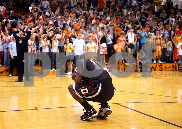 Beck Diefenbach – bdiefenbach@daily-chronicle.com<br /> <br /> DeKalb guard Darius McNeal (11) reacts after the loss to South Elgin in Class 4A regional semi-final game at DeKalb High School in DeKalb, Ill., on Wednesday March 4, 2009.